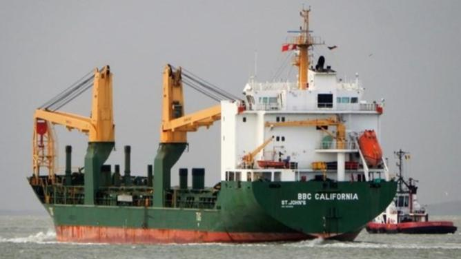 Some crew taken off virus-affected cargo ship and put in hotel quarantine