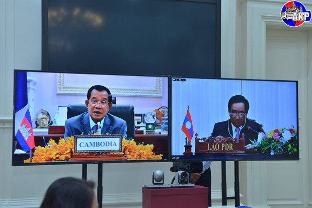 Samdech Techo Hun Sen, Phankham Viphavanh, video conference, cordial relations, partnership action plan, two-way trade, Agreement on the Avoidance of Double Taxation, multilateral collaboration, Vietnam News Agency, Related stories Cambodia, Related stories Laos, Samdech Techo Hun Sen, Phankham Viphavanh, video conference, cordial relations, partnership action plan, two-way trade, Agreement on the Avoidance of Double Taxation, multilateral collaboration, Vietnam News Agency, Vietnamplus