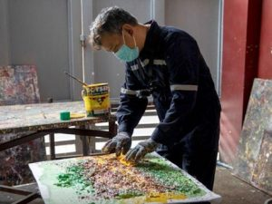 Philippine artist turns waste into paintings