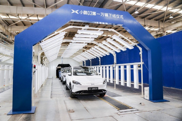 Xpeng Motors, defying Elon Musk's derisions, Tesla's lead, founder and chief executive He Xiaopeng, Toyota's venture with GAC, newspaper's owner Alibaba Group Holding, NIO, Li Auto