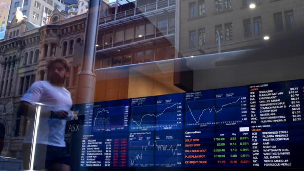 ASX higher as Evergrande pledges to pay