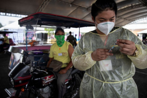 ADB cuts Asia growth forecast on slow Covid-19 vaccine roll-out