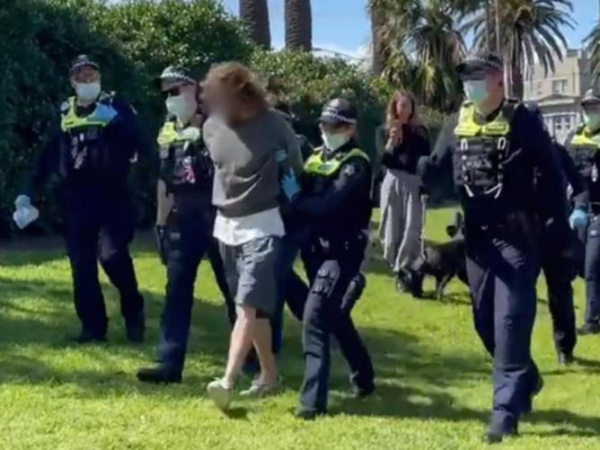 Police make first arrests as protesters plan to march outside Luna Park in St Kilda