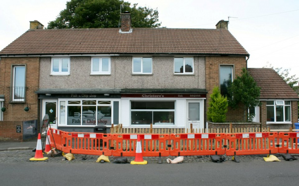 Couple 'shot at' after building 4ft fence to stop people queueing for fish and chip outside home as man, 34 arrested